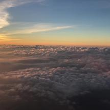 Sunset above the clouds flying away from Phuket Thailand