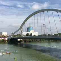 Canoes passing by the bridge of the barges at the Canal de Alfonso XIII in Seville Spain