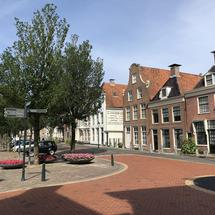 Houses next to the north harbor canal in Harlingen, Friesland The Netherlands