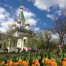 Tulips and flower in front of the Church of St Nicholas the Miracle-Maker, a Russian Orthodox church in central Sofia Bulgaria