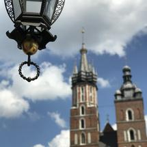 Lantern with in the background the St. Mary's Basilica in Krakow Poland