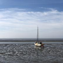 Sailboat on a sand plate around around Ameland island during low tide in Friesland The Netherlands