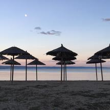 Panorama from parasols during sunset in Nees Pagases Greece