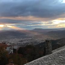 Time lapse from sunshine shining over the city Volos in Greece