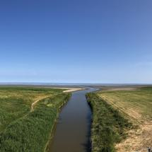 Panorama from a river towards the wadden sea around Zwarte Haan in Friesland The Netherlands