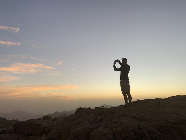 Taking a photo during sunset at Roque Nublo on Gran Canaria