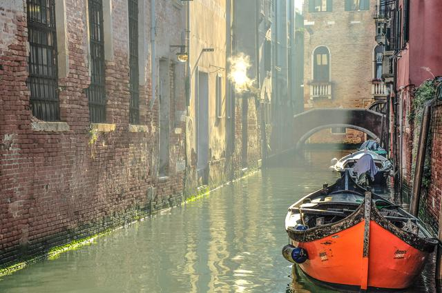 Red boat on Venice's canals