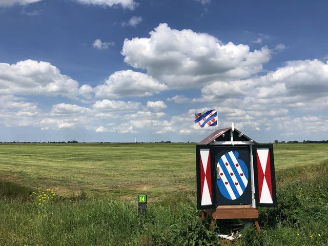 Frisian box and flag around It Heidenskip in Friesland, The Netherlands