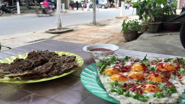Banh trang kep, grilled cake with pork liver pate and grilled cake with quail eggs in Hoi An Vietnam