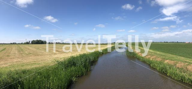 Panorama from farmland and a canal in Friesland, The Netherlands