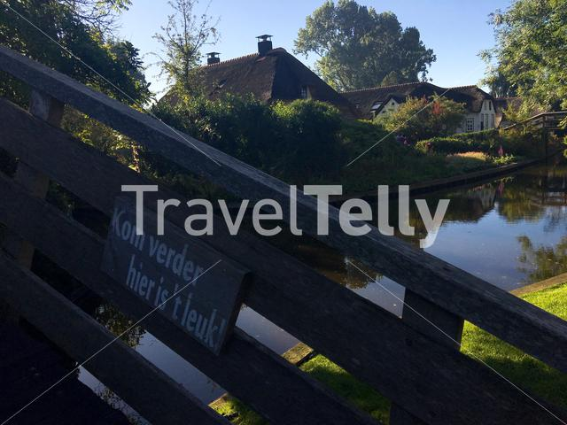 Bridge with a dutch sign come in its nice here in Giethoorn The Netherlands