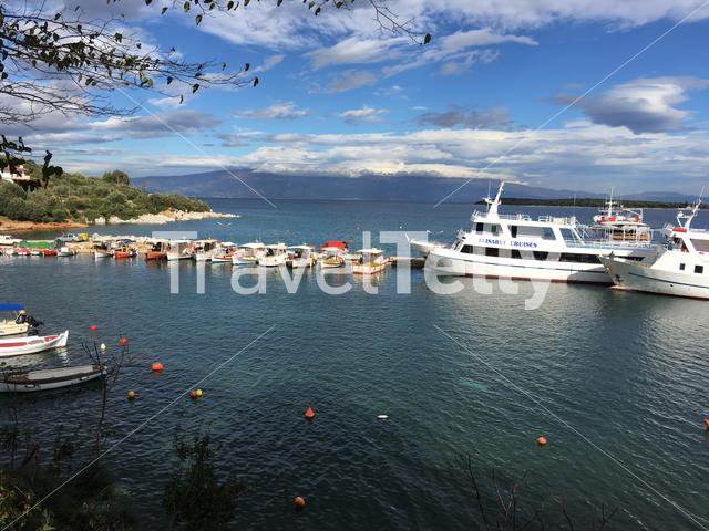 Harbour cruise ships and fishing boats in Amaliapoli Greece