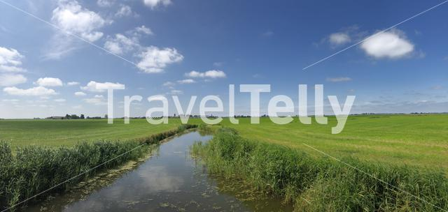 Panorama from a canal and farmland around Westhem, Friesland, The Netherlands