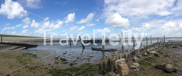 Panorama from low tide with a sunken boat in Texel The Netherlands