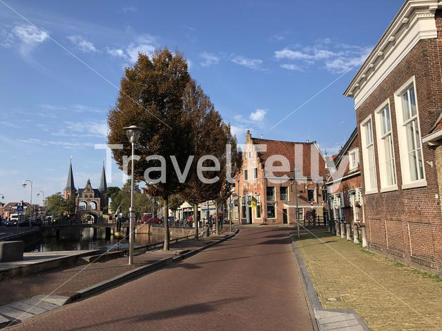 Old town of Sneek with the Waterpoort in the background in Friesland The Netherlands