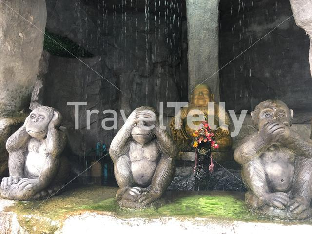 Buddha and monkeys statue at the entrance at the golden mount in Bangkok Thailand