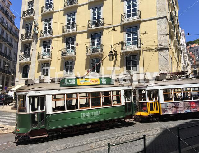 Two trams in the streets of Lisbon Portugal