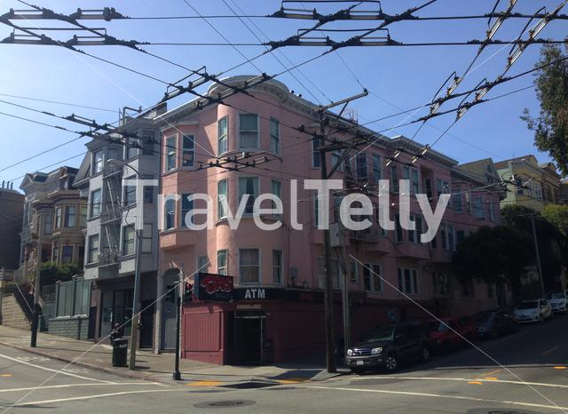 Pink house with bus cables in San Francisco, California, United States