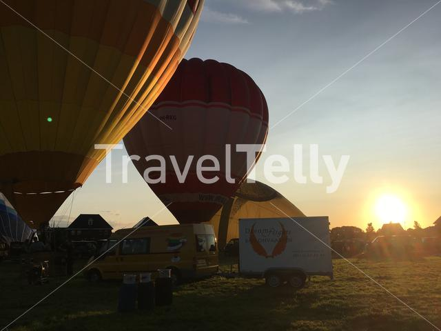 Hot air balloons, with sunset.