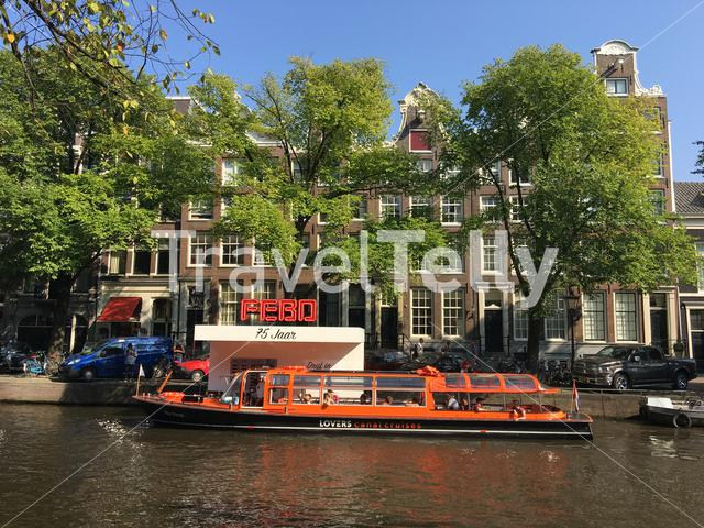 Canal cruise at a snack corner in the canals of Amsterdam The Netherlands