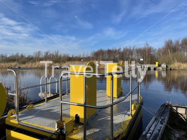 Manual ferry around nature reserve De Deelen on a winter day in Friesland The Netherlands
