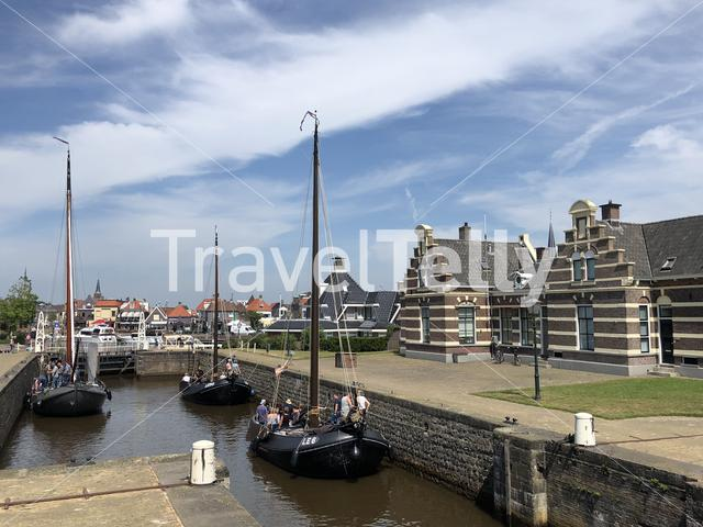 Sailboats in the sea lock in Lemmer, Friesland The Netherlands