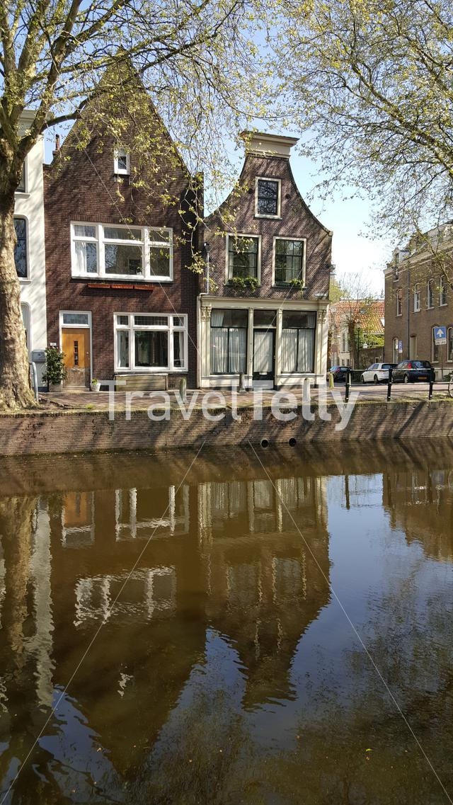 Reflection of Dutch architecture in canal of Gouda, The Netherlands