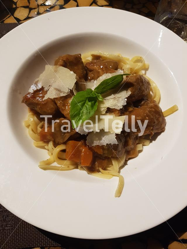 Braised Pork Tenderloin on Fetucine Pasta