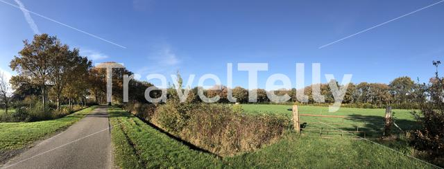 Panorama from a road during autumn around Nijemirdum in Friesland, The Netherlands