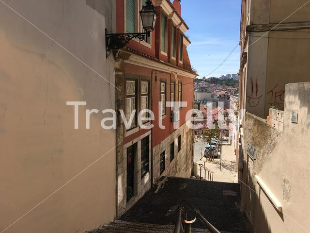 Narrow street with stairs in Lisbon portugal