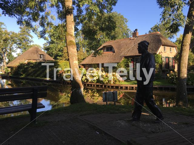 Statue next to a canal in Giethoorn The Netherlands