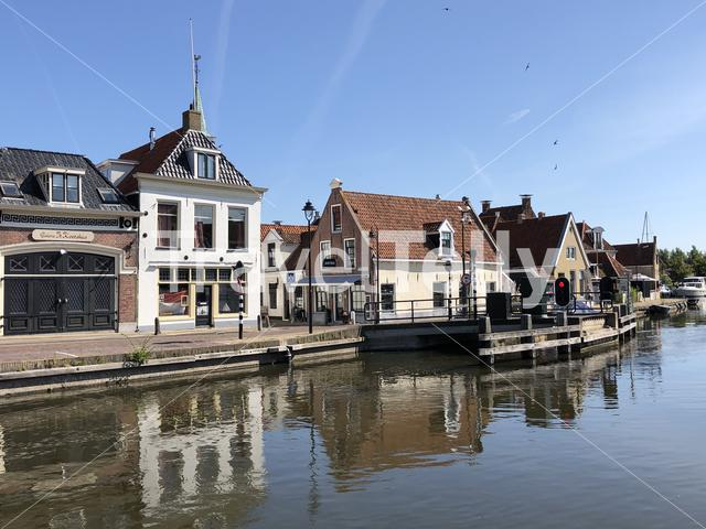 Houses next to a canal in the old town of Makkum, Friesland, The Netherlands