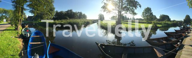 Panorama from boats in a canal in Giethoorn The Netherlands