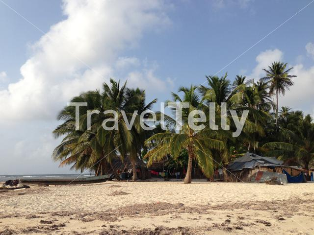 Boat and houses at the san blas islands in Panama
