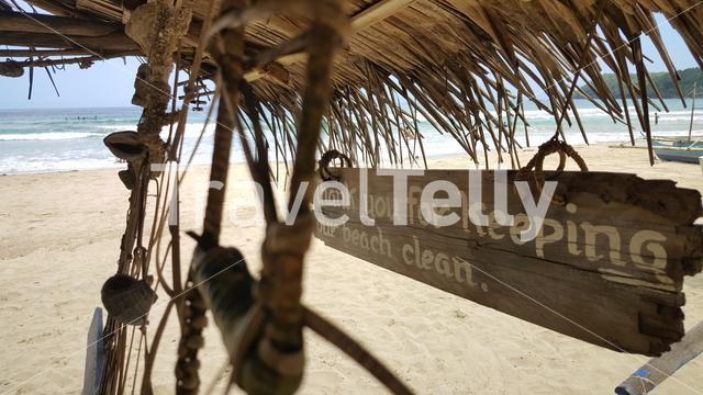 Keep beach clean sign on hut at tropical beach Nagtabon