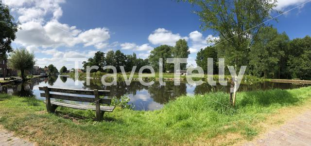 Bench next to the canal of the turfroute in Gorredijk, Friesland The Netherlands