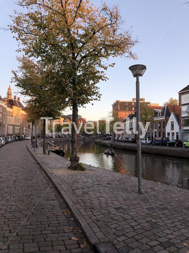 Canal around the old town during autumn in Groningen The Netherlands