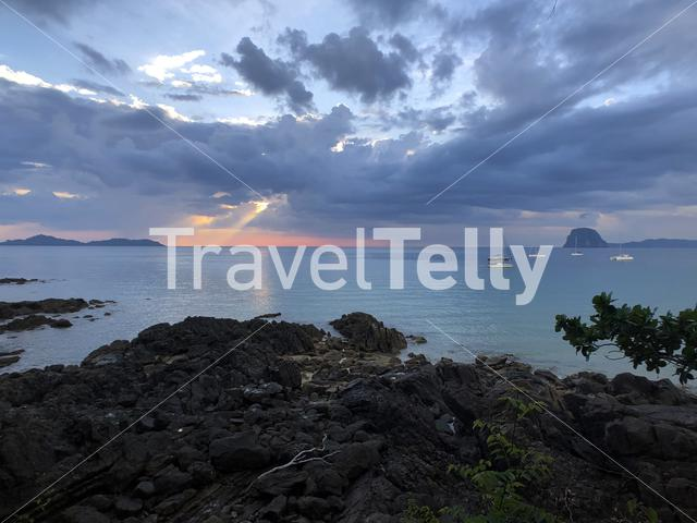 Cloudy sunset on Farang Beach on Koh Mook island in Thailand