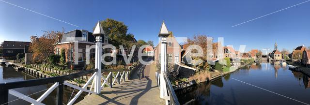 Panorama from a bridge over a canal in Hindeloopen during autumn in Friesland, The Netherlands