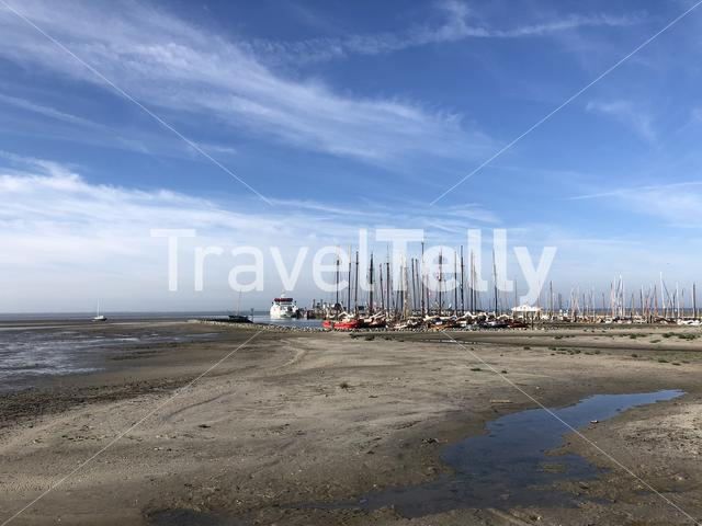 Harbor on Ameland island during low tide in Friesland The Netherlands
