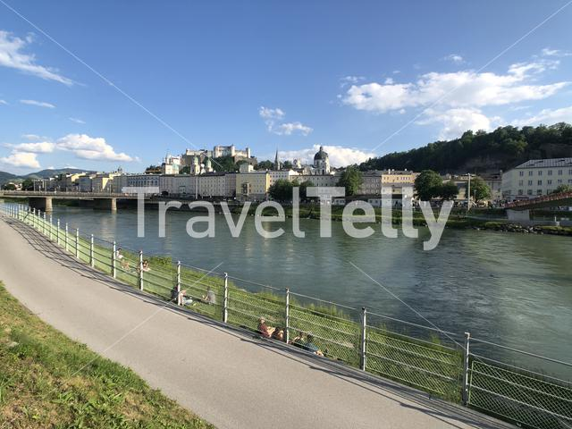 Relaxing along the Salzach river in Salzburg, Austria