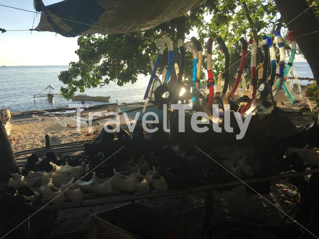 Snorkeling gear hanging at the beach with sunshine of Balicasag Island in Bohol the Philippines