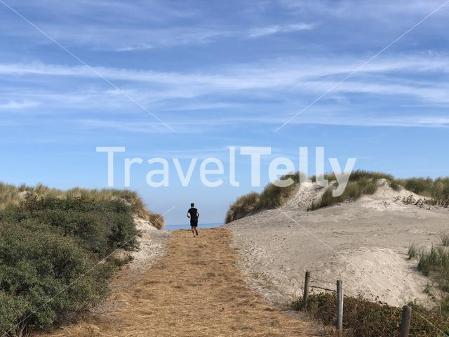 Running towards the beach on Ameland island in Friesland The Netherlands