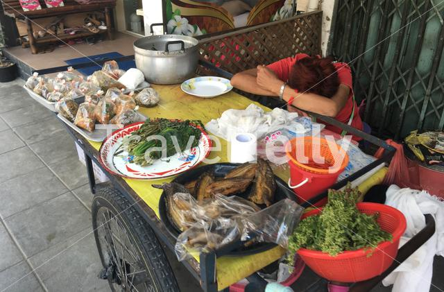 Tired from work in the streets of Bangkok