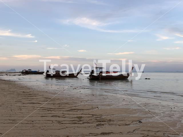Long-tail boats during low tide on Koh Ngai in Thailand