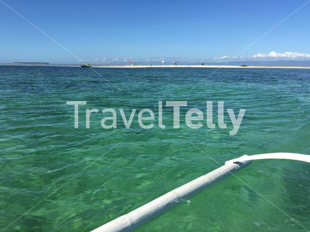 Leaving a small island with a Catamaran Boat in Panglao bay, Bohol the Philippines