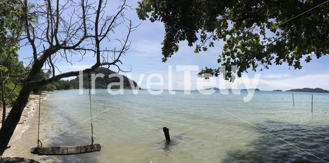 Panoramic view from a tree swing on Long Beach at Koh Chang Island in Thailand