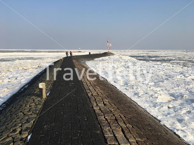 The pier during winter in the harbor of Terschelling The Netherlands