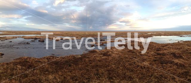 Iceland landscape with melting snow water during sunset Panorama