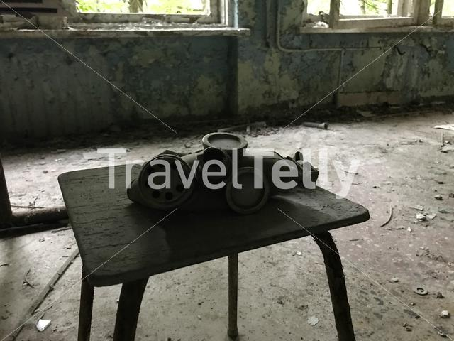 Gas mask on a table in a school at Pripyat a ghost town in northern Ukraine